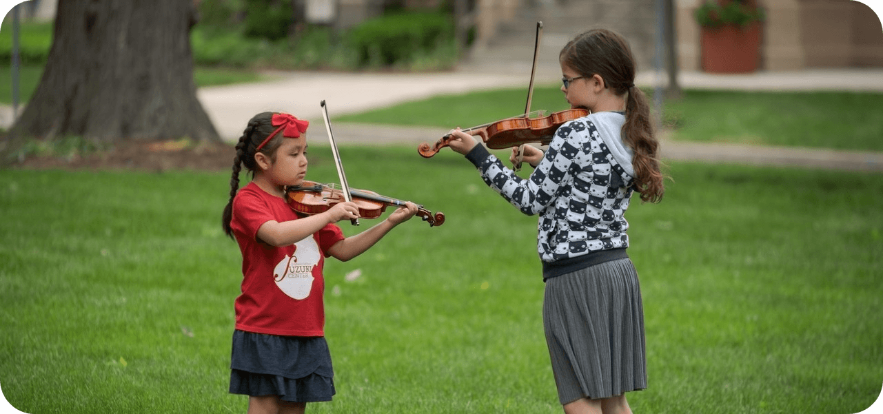 young violinists playing on BW campus