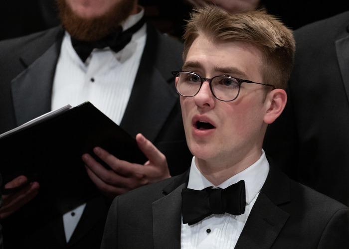 man sings at BW Men's Chorus performance