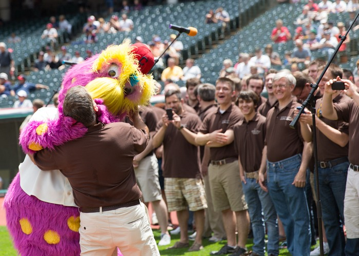 men's singing group with Slider at Cleveland Indian's game and performance