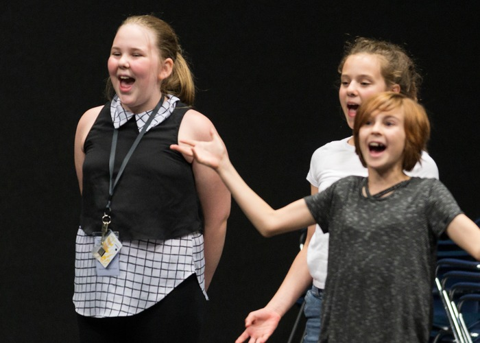 girls singing on stage at Middle School Music Theater Camp