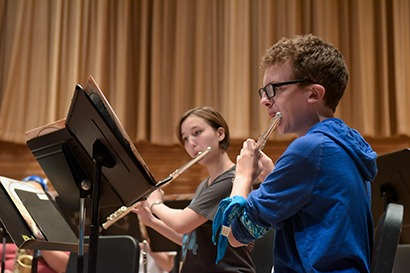 Two Conservatory Summer Institute students playing flute